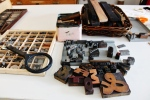 These are some of the basic tools you need to create a letterpress print. Featured in this picture is the furniture needed for spacing, lead types, and spacers.